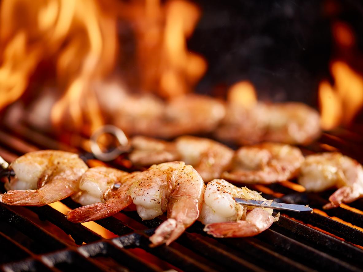 skewers of shrimp on hot grill; Grilled Cajun Shrimp Skewers 2021 Jane Bonacci, The Heritage Cook