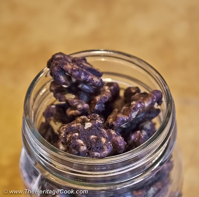 Close up of jar of chocolate coated walnuts