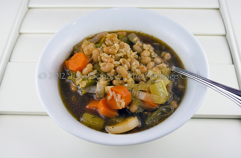 Beef soup in white bowl on white shutters