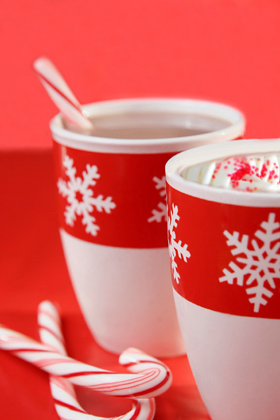 Mugs of hot chocolate with candy canes