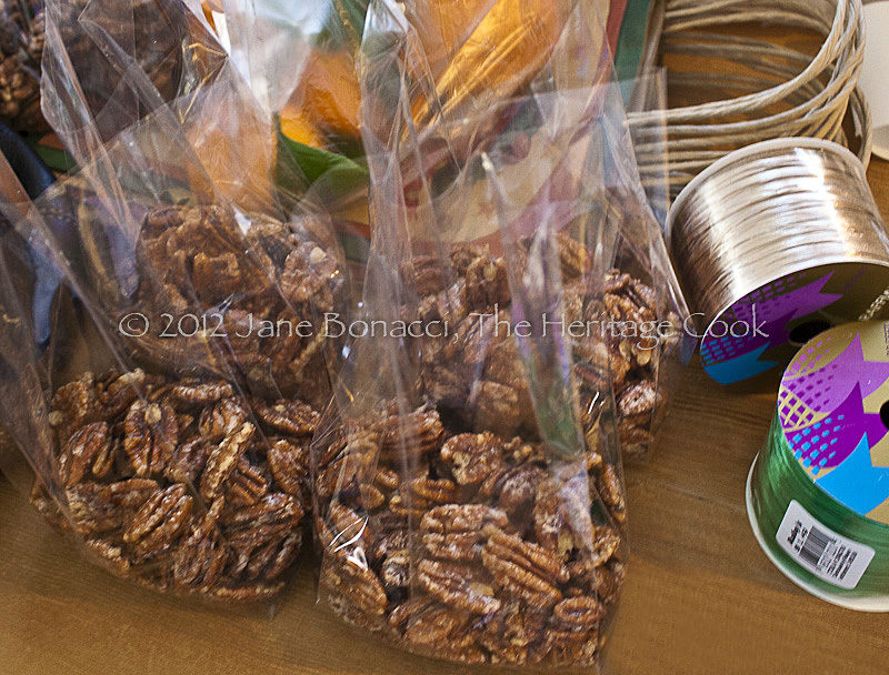 Candied nuts in bags ready to be tied shut