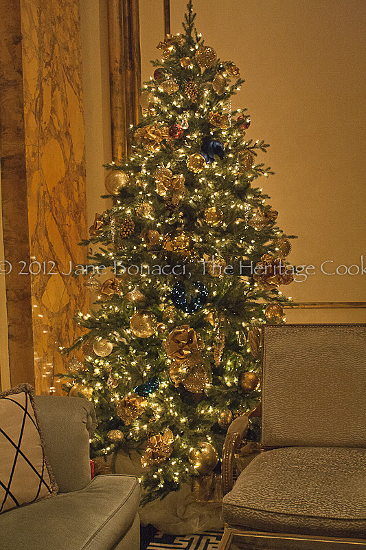 Gold decked tree tucked into the corner of the lobby