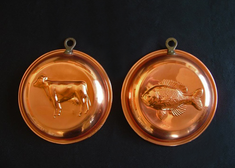 Copper molds make beautiful kitchen wall hangings
