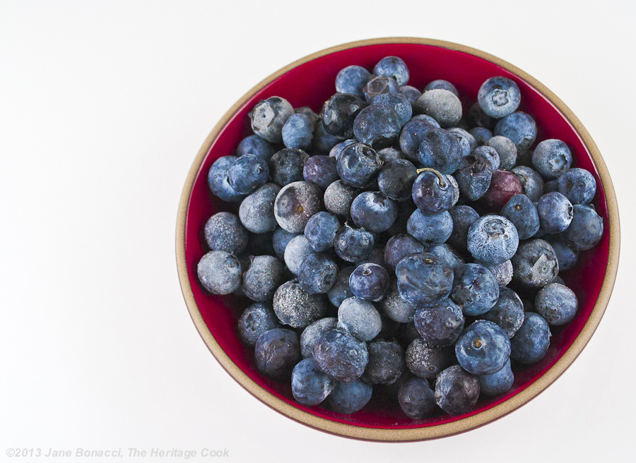 Homemade Blueberry Jam from The Heritage Cook; bowl of fresh blueberries on a white background