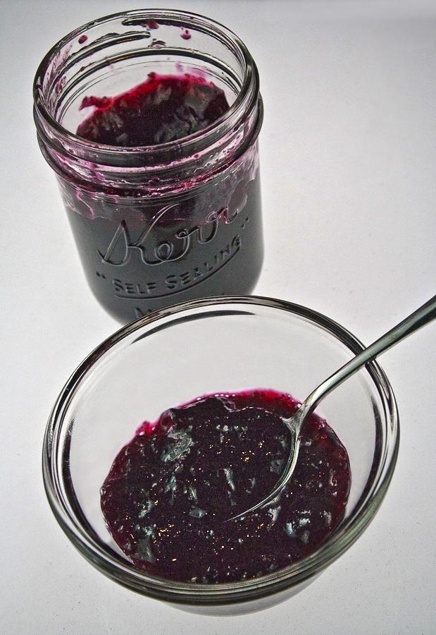 Homemade Blueberry Jam from The Heritage Cook; bowl with fresh blueberry jam and spoon