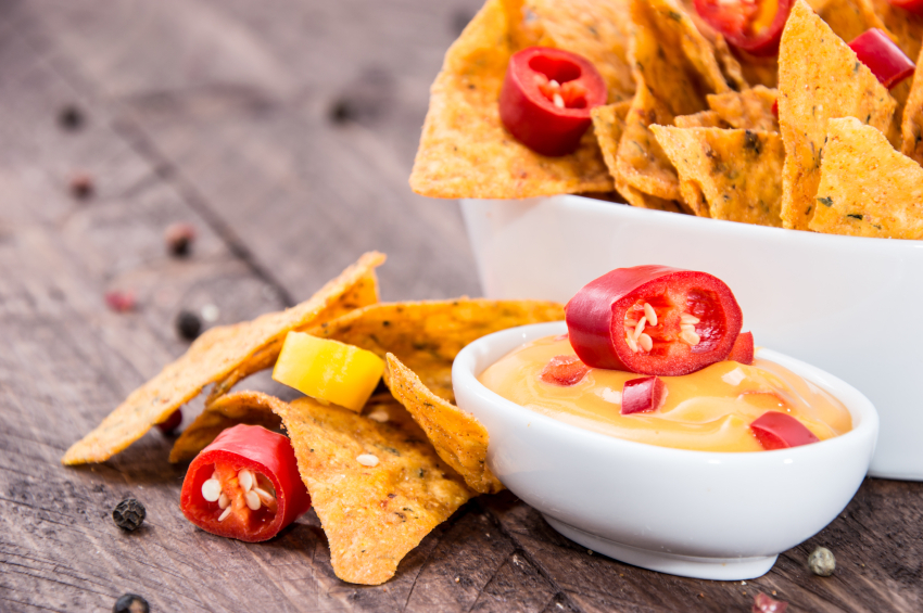 Bowl of Mexican Cheese Dip with Chips