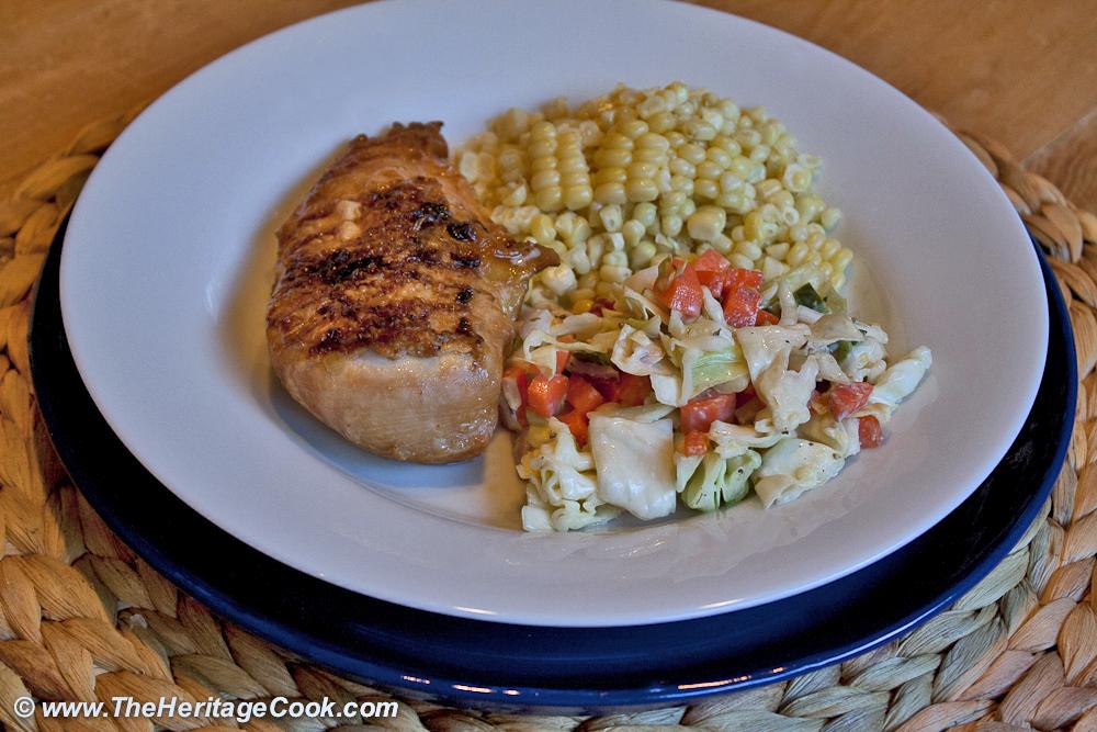 Chicken breast dinner on white plate