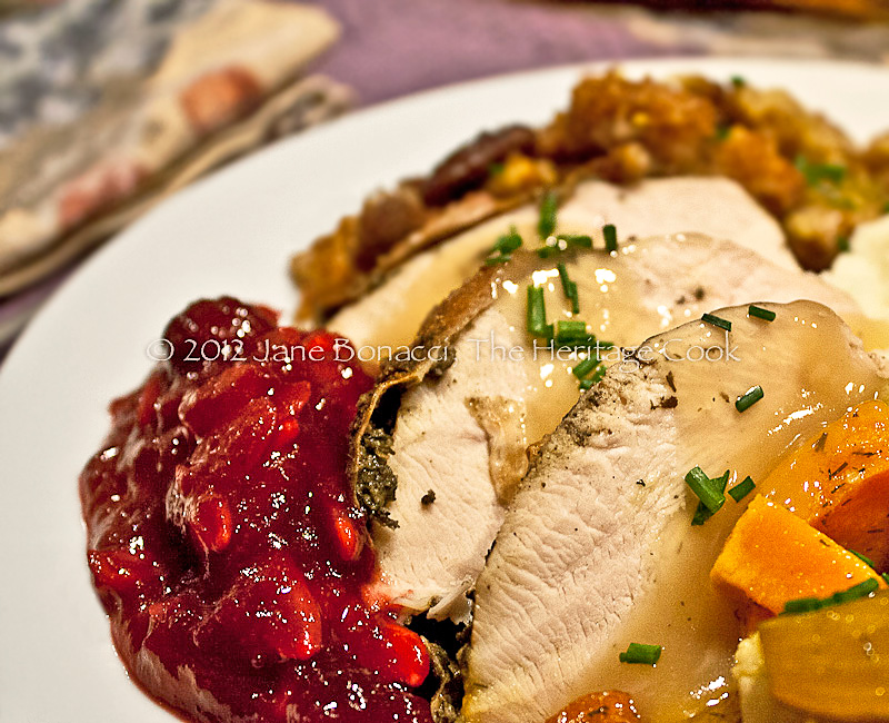 Sliced turkey with gravy and homemade cranberry sauce