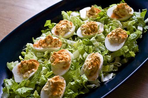 Deviled Eggs on a bed of shredded lettuce for Easter