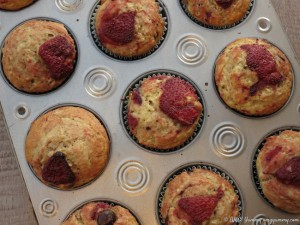 Baked muffins in their tins; Banana Chocolate Chip Muffins with Roasted Strawberries; © Beth Lee 2016