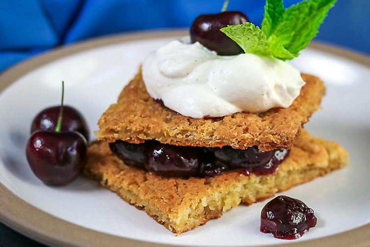 Fresh Cherries sandwiched between tender shortcake biscuit-scones; Fresh Cherry Shortcakes with White Chocolate Whipped Cream © 2017 Jane Bonacci, The Heritage Cook