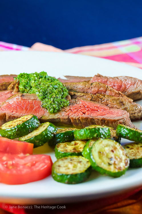 Dinner of flank steak with chimichurri sauce, heirloom tomatoes, and sauteed zucchini; Flank Steak with Fresh Chimichurri Sauce #ProgressiveEats © 2017 Jane Bonacci, The Heritage Cook