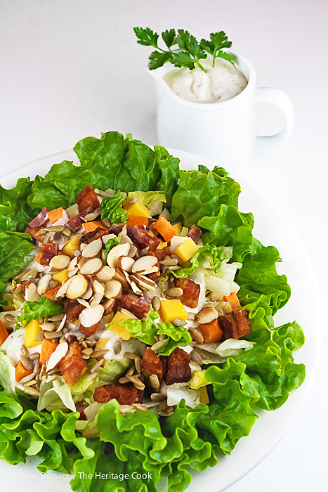 Salad in front of pitcher of dressing; Gluten Free Chopped Meats and Cheese Salad with Ranch-Style Dressing © 2019 Jane Bonacci, The Heritage Cook