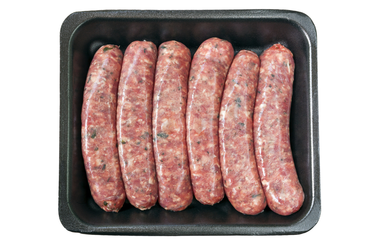 raw sausages on tray; Mexican Potato Sausage Casserole © 2021 Jane Bonacci, The Heritage Cook