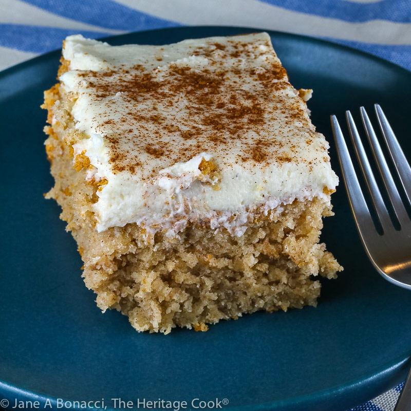 slice of cake on blue plate; Snickerdoodle Cake with White Chocolate Frosting © 2021 Jane Bonacci, The Heritage Cook