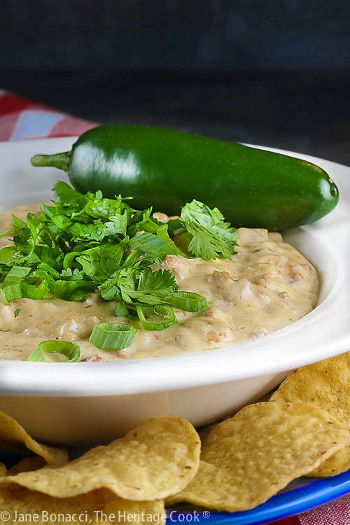 jalapeno pepper on edge of bowl; Chorizo Queso Blanco Dip © 2021 Jane Bonacci, The Heritage Cook